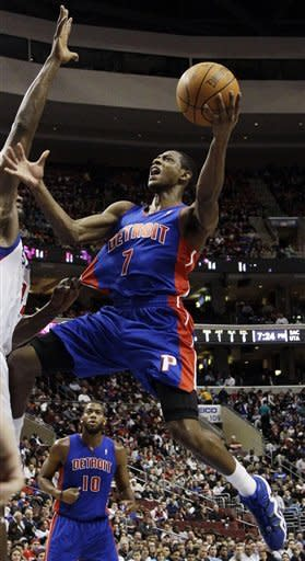 Detroit Pistons' Brandon Knight, right, shoots as Philadelphia 76ers' Elton Brand defends in the first half of an NBA basketball game, Saturday, Jan. 28, 2012, in Philadelphia. (AP Photo/Matt Slocum)