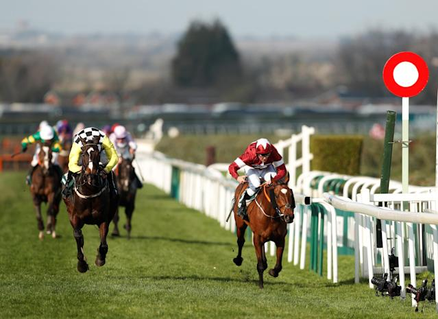 Horse Racing - Grand National Festival - Aintree Racecourse, Liverpool, Britain - April 14, 2018 Tiger Roll ridden by Davy Russell (R) crosses the line as he wins the 17:15 Randox Health Grand National Handicap Chase Action Images via Reuters/Matthew Childs