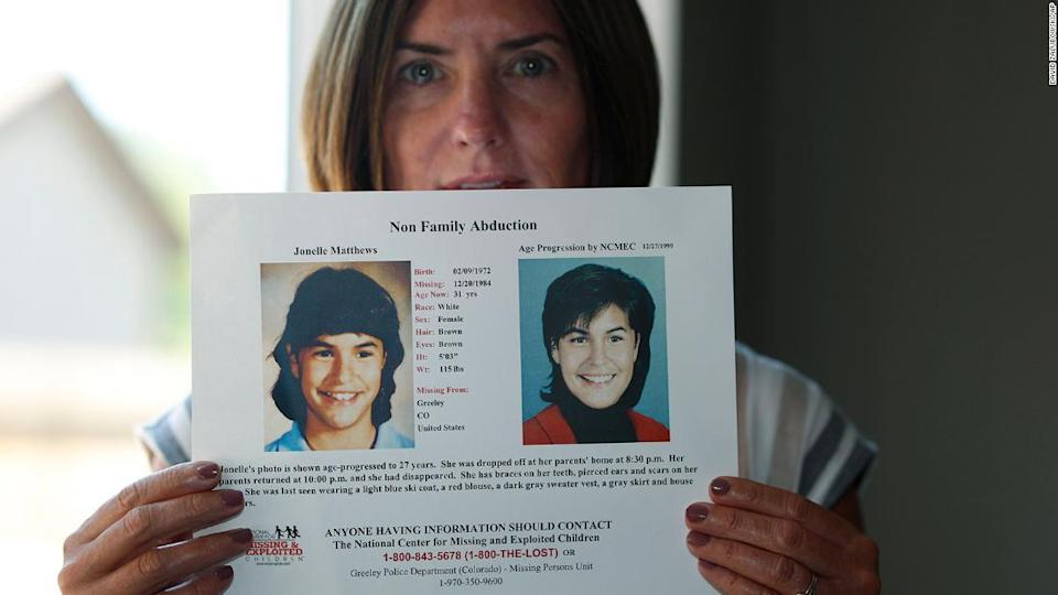 """<p>Jennifer Mogensen holds a poster of her adopted sister, Jonelle Matthews after her remains were discovered in 2019.</p><div class=""""cnn--image__credit""""><em><small>Credit: David Zalubowski/AP / Associated Press</small></em></div>"""
