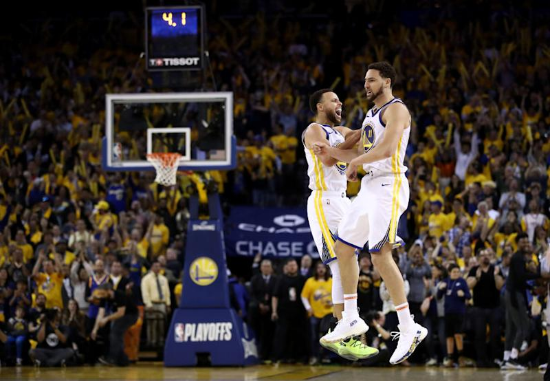 Stephen Curry #30 of the Golden State Warriors celebrates with Klay Thompson #11 after Thompson made the clinching basket with four second left of their game against the Houston Rockets in Game Five of the Western Conference Semifinals of the 2019 NBA Playoffs at ORACLE Arena on May 8, 2019 in Oakland, California. | Ezra Shaw—Getty Images