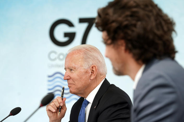 """FILE - In this June 11, 2021, file photo, President Joe Biden and Canadian Prime Minister Justin Trudeau attend the G-7 summit at the Carbis Bay Hotel in Carbis Bay, St. Ives, Cornwall, England. Biden and his NATO counterparts bid a symbolic farewell to Afghanistan on Monday, June 14, in their last summit before America winds up its longest """"forever war"""" and the military pulls out for good. (Kevin Lamarque/Pool via AP, File)"""