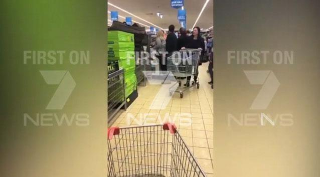 Some other shoppers appeared to try and break the two parties. Photo: Supplied