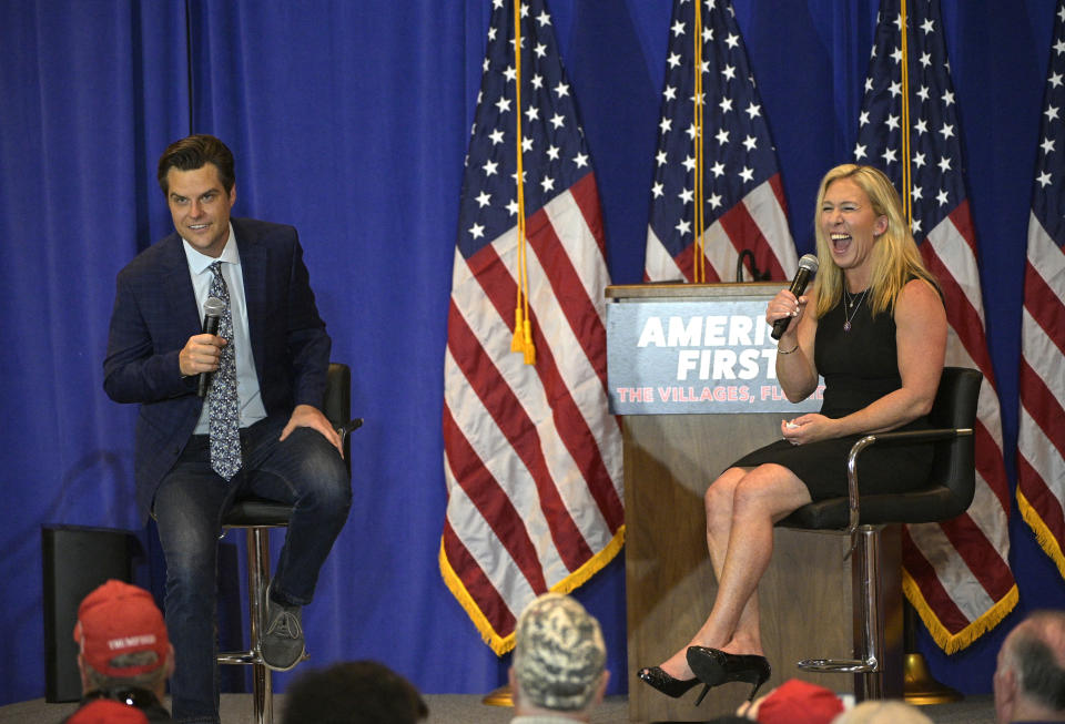 FILE - In this May 7, 2021, file photo, Rep. Matt Gaetz, R-Fla., left, and Rep. Marjorie Taylor Greene, R-Ga., address attendees during a rally in The Villages, Fla. A third event venue in California has canceled a Saturday, July 17, night rally by Reps. Gaetz and Taylor Greene. A spokesman for the city of Anaheim announced the latest cancellation on Saturday, hours before the rally was scheduled to begin. Two venues in nearby cities previously canceled plans to host the event. (AP Photo/Phelan M. Ebenhack. File)