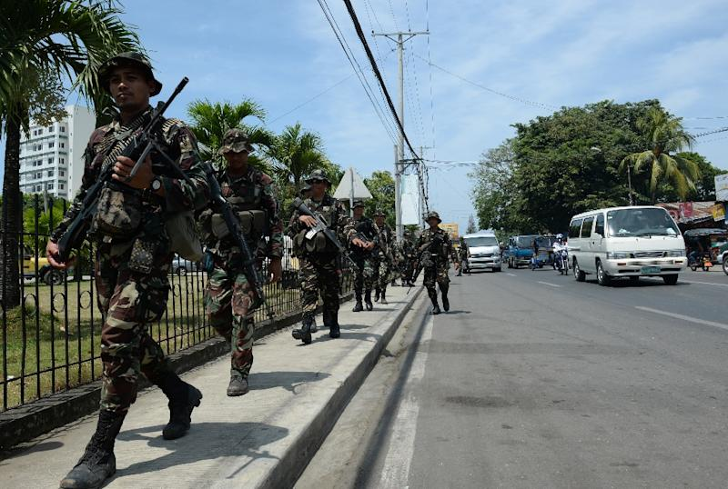 Philippine soldiers patrol the streets in Zamboanga, on southern island of Mindanao (AFP Photo/Ted Aljibe)
