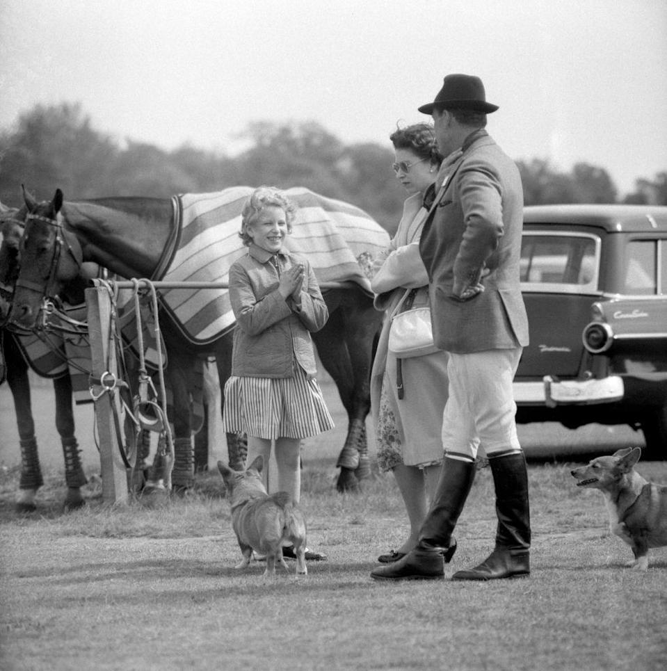 <p>A young Anne seems quite excited about something, as she hangs out with her mother and to corgis on the sidelines of Prince Philip's polo match.<br></p>