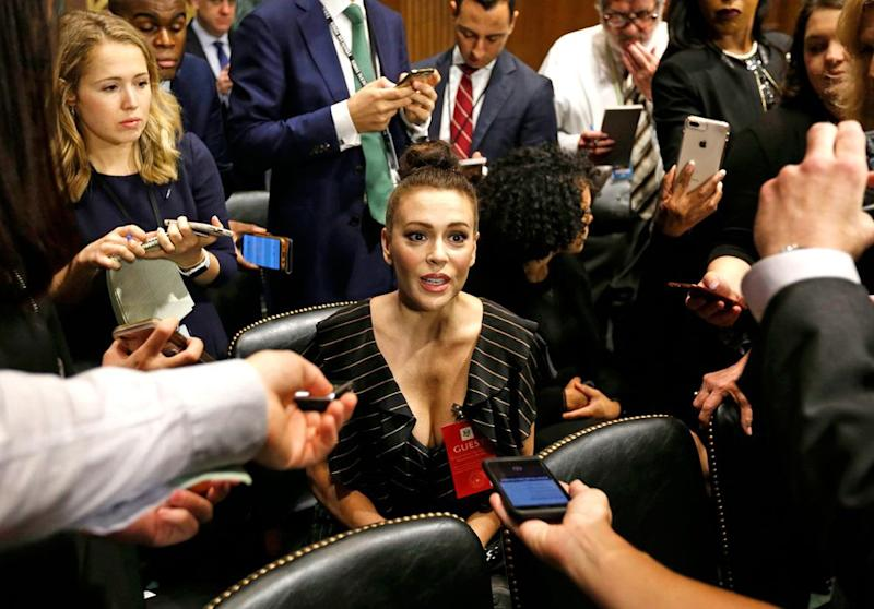 Alyssa Milano speaks with reporters before the Senate confirmation hearing on Brett Kavanaugh in September | MICHAEL REYNOLDS/AFP/Getty