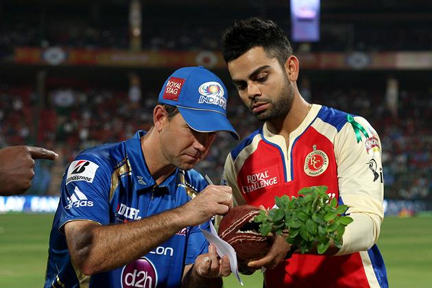 Captains Ricky Ponting and Virat Kohli during the coin-toss before match 2 of of the Pepsi Indian Premier League between The Royal Challengers Bangalore and The Mumbai Indians held at the M. Chinnaswamy Stadium, Bengaluru on the 4th April 2013. Photo by Jacques Rossouw/IPL/SPORTZPICS  ..Use of this image is subject to the terms and conditions as outlined by the BCCI. These terms can be found by following this link:..https://ec.yimg.com/ec?url=http%3a%2f%2fwww.sportzpics.co.za%2fimage%2fI0000SoRagM2cIEc&t=1493180344&sig=xArkkh64a3BRAk7N0yow9Q--~C
