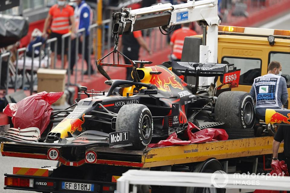 """The car of Max Verstappen, Red Bull Racing RB16, is returned to the pits on a truck after the race<span class=""""copyright"""">Glenn Dunbar / Motorsport Images</span>"""