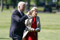 President Joe Biden walks with first lady Jill Biden from Marine One upon arrival on the Ellipse at the White House, Monday, May 31, 2021, in Washington. (AP Photo/Alex Brandon)