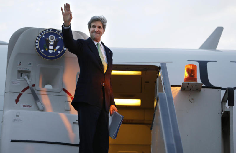 U.S. Secretary of State John Kerry waves goodbye as he leaves Cairo, Egypt en route to Riyadh, Saudi Arabia on Sunday, March 3, 2013. Kerry met with Egypt's president Sunday, wrapping up a visit to the deeply divided country with an appeal for unity and reform. The U.S. is deeply concerned that continued instability in Egypt will have broader consequences in a region already rocked by unrest. (AP Photo/Jacquelyn Martin, Pool)
