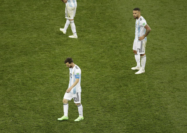 Argentina's Lionel Messi, left, and Argentina's Nicolas Otamendi react at the end of the group D match between Argentina and Croatia at the 2018 soccer World Cup in the Nizhny Novgorod stadium in Nizhny Novgorod, Russia, Thursday, June 21, 2018. (AP Photo/Michael Sohn)