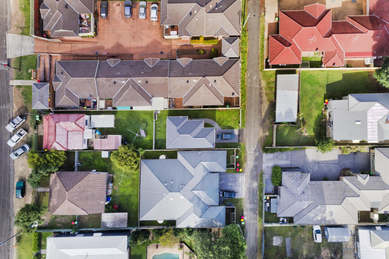 Roof tops and yards of residential homes in Cessnock town of Hunter Valley region of Australia. QUiet lifestyle and comfortable living between green lawns.