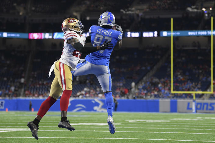 Detroit Lions wide receiver Quintez Cephus (87) catches a touchdown pass as San Francisco 49ers defensive back Dontae Johnson defends in the second half of an NFL football game in Detroit, Sunday, Sept. 12, 2021. (AP Photo/Lon Horwedel)