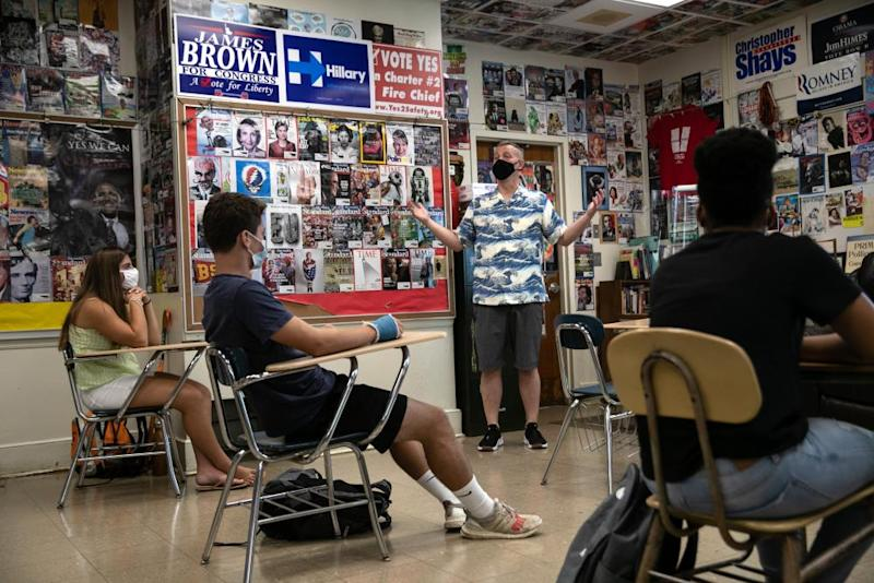 Honors Civics teacher Mike Brown discusses the upcoming U.S. Presidential election with masked students on the first day of school at Stamford High School in Connecticut on September 8th.