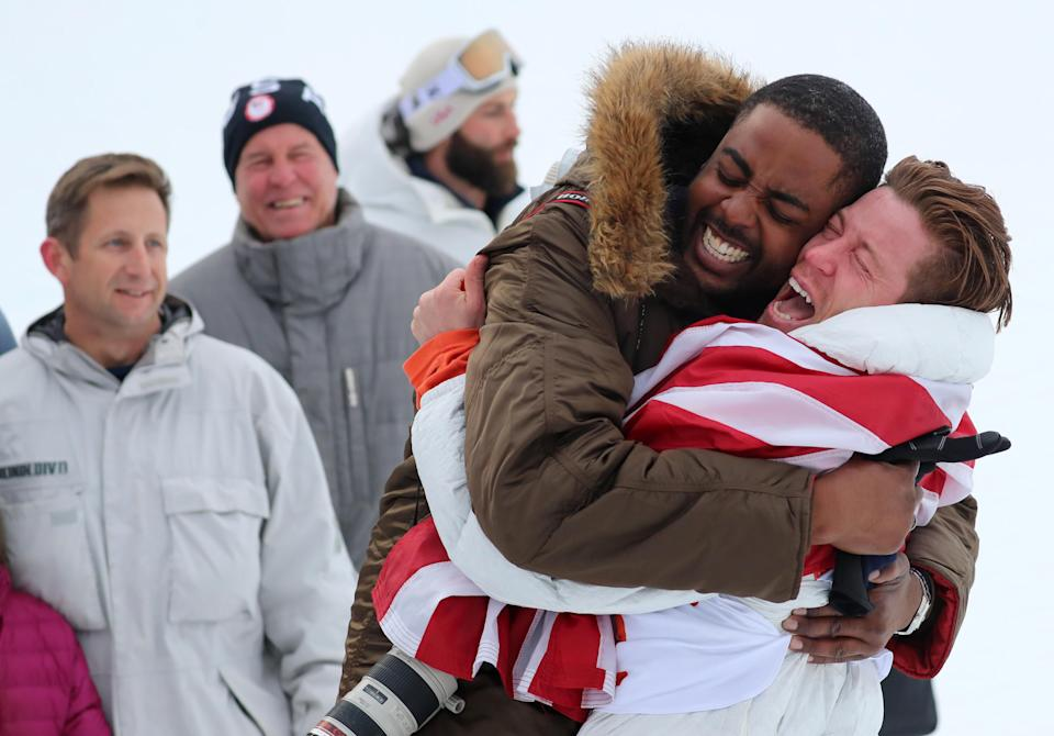 <p>Gold medallist Shaun White of the U.S. hugs a friend competes. REUTERS/Mike Blake </p>