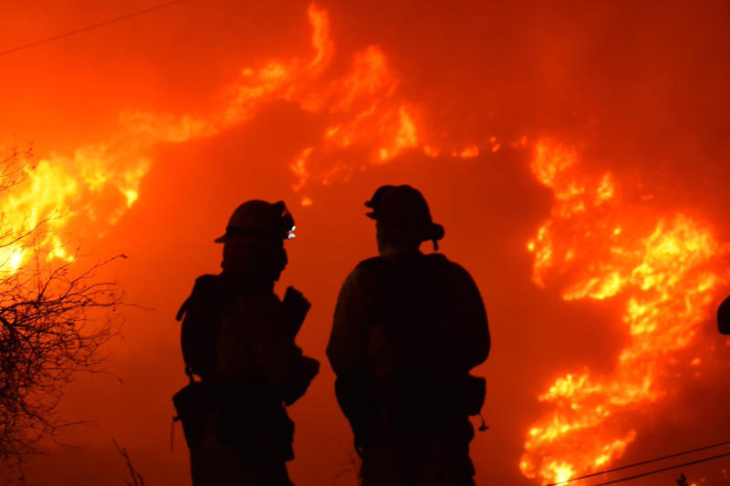 Firefighters forced to step aside as winds powered infernos