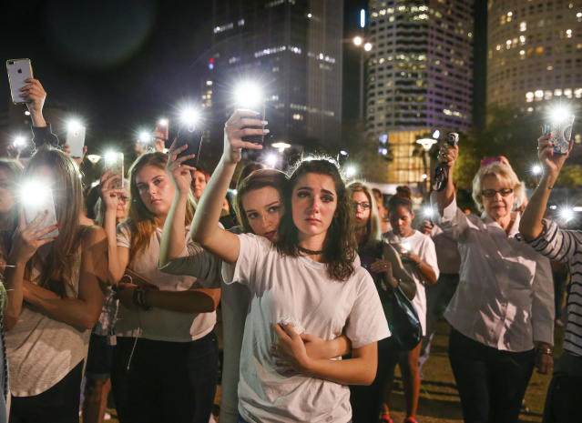 Students attend a vigil in Tampa, Fla., to honor victims of last week's mass shooting at Marjory Stoneman Douglas High School in Parkland, Fla. Photo: Dirk Shadd/Tampa Bay Times via AP
