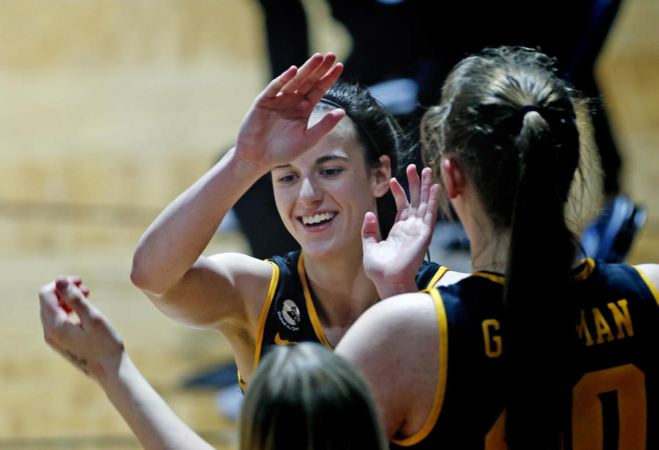 Iowa guard Caitlin Clark is congratulated as she heads to the bench during the second half of the team's college basketball game against Kentucky in the second round of the NCAA women's tournament at Greehey Arena in San Antonio, Tuesday, March 23, 2021. Iowa defeated Kentucky 86-72. (AP Photo/Ronald Cortes)