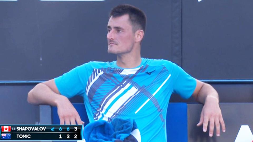 Bernard Tomic (pictured) relaxing between points at the Australian Open.