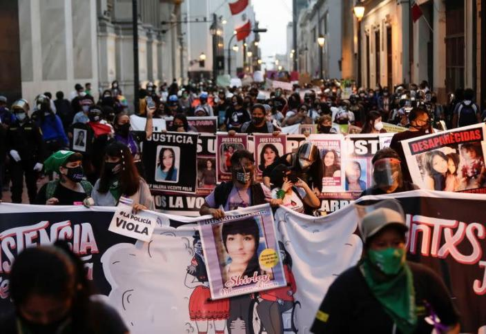 Demonstrators march during a protest to mark the International Day for the Elimination of Violence against Women, in Lima