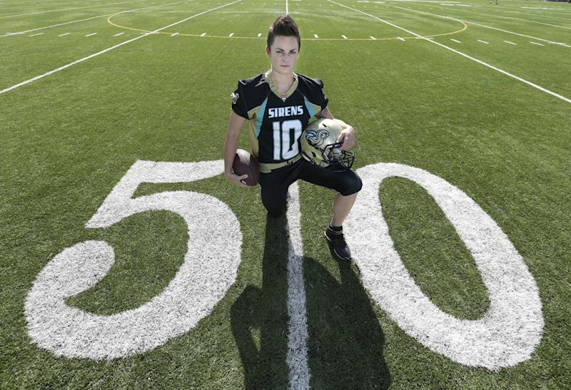 "Holly Peterson, who plays professional women's tackle football for the Sacramento Sirens, is photographed on the field in Elk Grove, Calif. on Friday, May 3, 2013. Peterson made the decision to tell her family and friends that she's a lesbian 14 years ago, when she was a sophomore in high school. ""I was ready,"" says Peterson, who's now 29. ""I needed to tell someone."" (AP Photo/Rich Pedroncelli)"