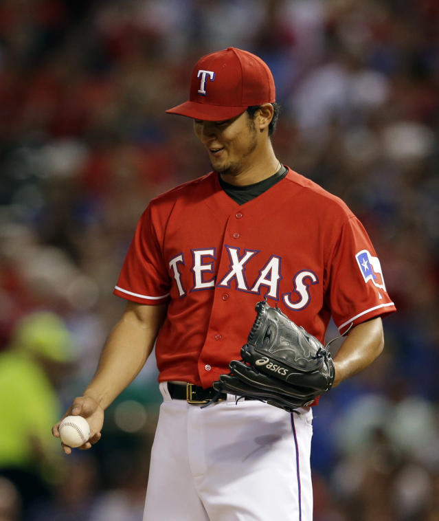 Texas Rangers' Yu Darvish, of Japan, stands at the back of the mound after talking with catcher Robinson Chirinos in the fourth inning of a baseball game against the Boston Red Sox, Friday, May 9, 2014, in Arlington, Texas. (AP Photo/Tony Gutierrez)