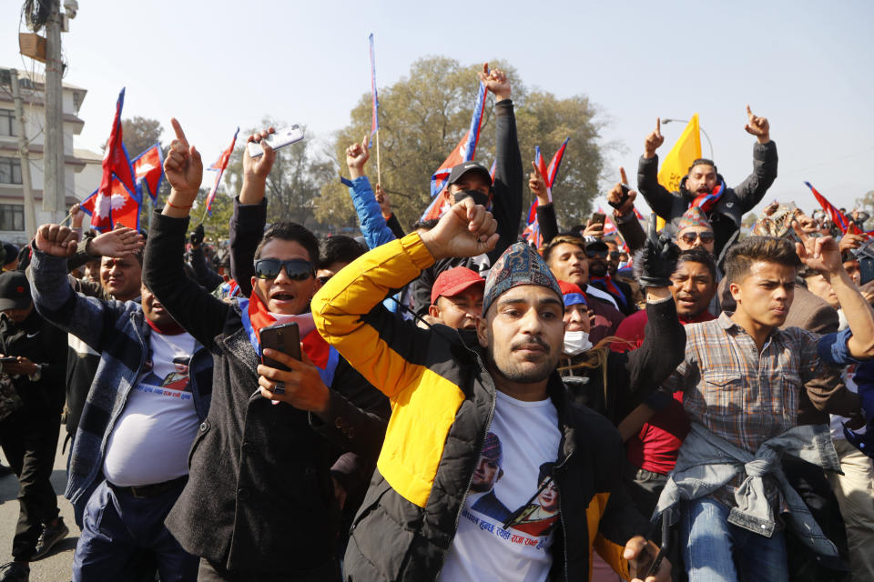 Nepalese pro-king supporters march demanding reinstating monarchy that was abolished more than a decade ago in Kathmandu, Nepal, Monday, Jan.11, 2021. Monday's protest was the latest anti-government protest against Prime Minister Khadga Prasad Oli who has been facing street demonstrations against him from a splinter faction of his own Communist party and more from opposition political groups for dissolving parliament. Nepal's centuries-old monarchy was abolished in 2008 by the parliament and replaced by a republic where the president was elected as the head of state. (AP Photo/Niranjan Shrestha)