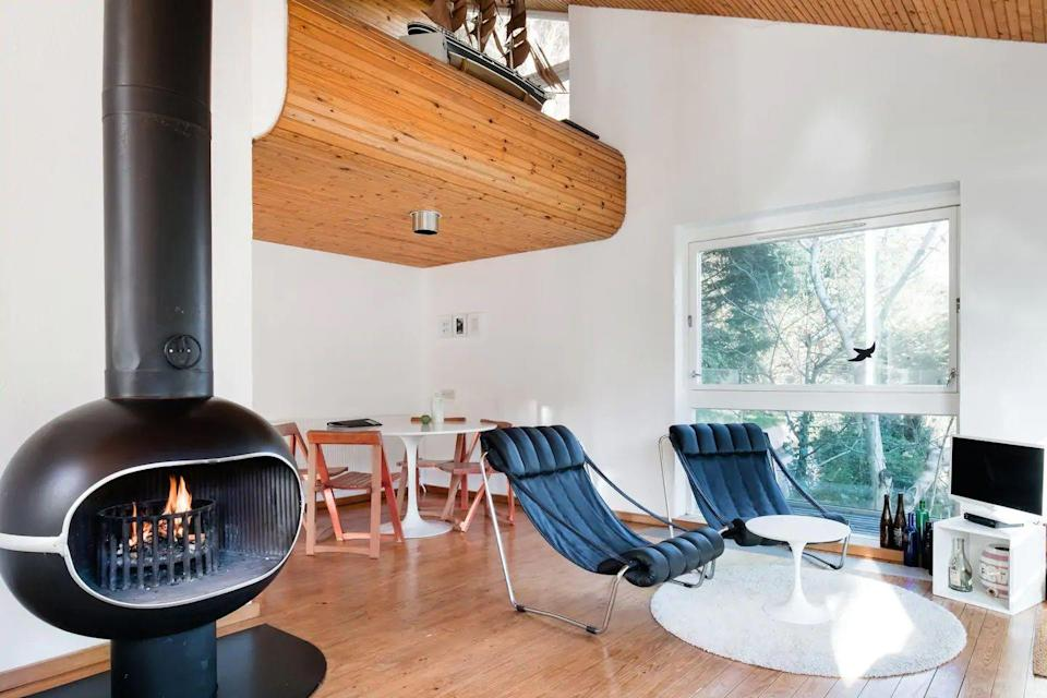 "<p>Architecture and design buffs, this one's for you. A fantastic base for walkers, beachgoers and active visitors, this Airbnb in Devon is sleek, retro and a spot that arty types will love.</p><p>Expect a red-tiled bathroom, one of the bedrooms in a Scandi style with yellow bunkbeds, a stylish fireplace and a dinghy and life vests available if you fancy rowing pretty Warfleet Creek.</p><p><strong>Sleeps</strong>: 4</p><p><strong>Price per night:</strong> £89</p><p><strong>Why we love it:</strong> The thoughtful touches: all the kit for getting active on the water, the River Dart view you can take in from the terrace, Netflix for when you want to rest.</p><p><a class=""link rapid-noclick-resp"" href=""https://go.redirectingat.com?id=127X1599956&url=https%3A%2F%2Fwww.airbnb.co.uk%2Frooms%2Fplus%2F13106371%2F&sref=https%3A%2F%2Fwww.countryliving.com%2Fuk%2Ftravel-ideas%2Fstaycation-uk%2Fg32930188%2Fairbnb-cornwall-devon%2F"" rel=""nofollow noopener"" target=""_blank"" data-ylk=""slk:SEE INSIDE"">SEE INSIDE</a></p>"