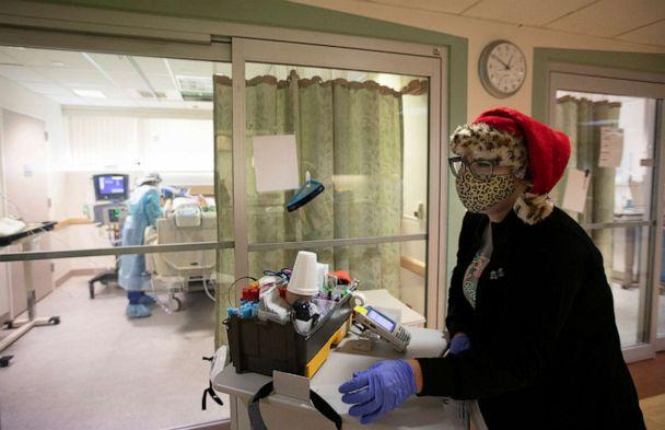PHOTO: Brenda Lorenzo wears a Santa hat and a leopard mask over her N95 as she works inside the ICU at Providence St. Jude Medical Center Christmas Day on Dec. 25, 2020, in Fullerton, Calif. (Francine Orr/Los Angeles Times via Getty Images)