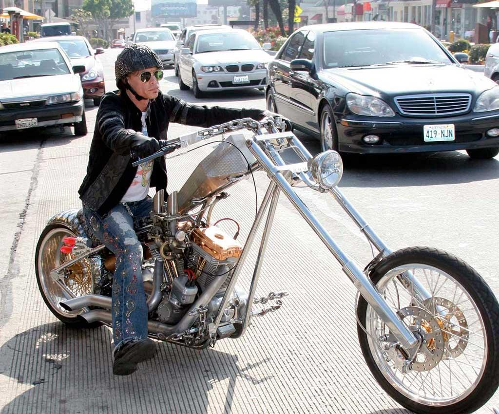 "Aerosmith's Steven Tyler takes his wild hog for a spin on the Sunset Strip. <a href=""http://www.x17online.com"" target=""new"">X17 Online</a> - July 24, 2006"