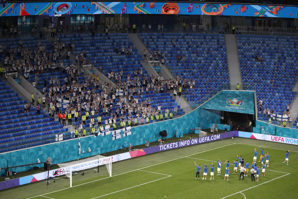 Finland fans applaud fans at the end of the Euro 2020 soccer championship group B match between Finland and Belgium at Saint Petersburg Stadium in St. Petersburg, Russia, Monday, June 21, 2021. (Anton Vaganov/Pool Photo via AP)