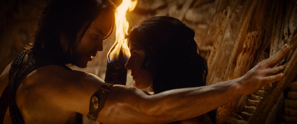 """Taylor Kitsch and Lynn Collins in Walt Disney Pictures' """"John Carter"""" - 2012"""