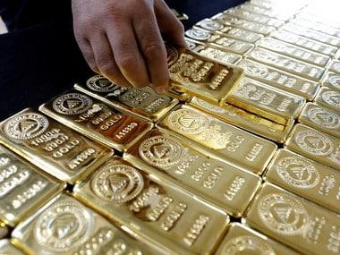 Gold hovers near five-week lows as firm dollar, optimism over likely US-China trade deal dent appeal