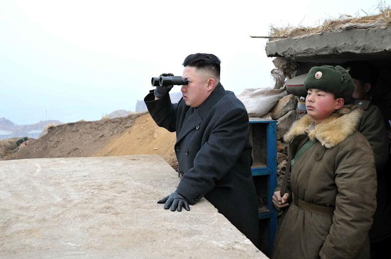 In this March 7, 2013 photo released by the Korean Central News Agency (KCNA) and distributed March 8, 2013 by the Korea News Service, North Korean leader Kim Jong Un, center, uses binoculars to look at the South's territory from an observation post at the military unit on Jangjae islet, located in the southernmost part of the southwestern sector of North Korea's border with South Korea. Seven years of U.N. sanctions against North Korea have done nothing to derail Pyongyang's drive for a nuclear weapon capable of hitting the United States. They may have even bolstered the Kim family by giving their propaganda maestros ammunition to whip up anti-U.S. sentiment and direct attention away from government failures. Defense Secretary Chuck Hagel plans to announce Friday that the Obama administration has decided to add 14 interceptors on the West Coast to the U.S.-based missile defense system. (AP Photo/KCNA via KNS) JAPAN OUT UNTIL 14 DAYS AFTER THE DAY OF TRANSMISSION