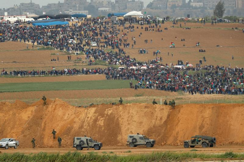 Some protesters have broken away from the main body of demonstrators to approach the border fence and throw stones and petrol bombs at Israeli soldiers on the other side