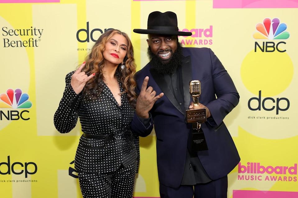 LOS ANGELES, CALIFORNIA - MAY 23: (L-R) Tina Knowles-Lawson and Trae tha Truth, winner of the Billboard Change Maker Award, pose backstage for the 2021 Billboard Music Awards, broadcast on May 23, 2021 at Microsoft Theater in Los Angeles, California. (Photo by Rich Fury/Getty Images for dcp)