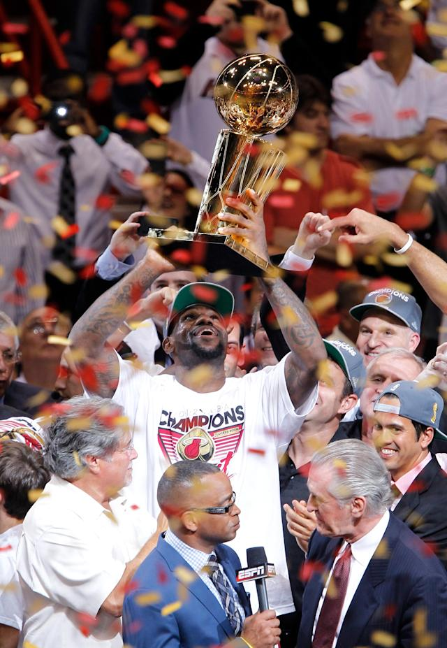 MIAMI, FL - JUNE 21: LeBron James #6 of the Miami Heat celebrates with the Larry O'Brien Finals Championship trophy after they won 121-106 against the Oklahoma City Thunder in Game Five of the 2012 NBA Finals on June 21, 2012 at American Airlines Arena in Miami, Florida. NOTE TO USER: User expressly acknowledges and agrees that, by downloading and or using this photograph, User is consenting to the terms and conditions of the Getty Images License Agreement. (Photo by Mike Ehrmann/Getty Images)