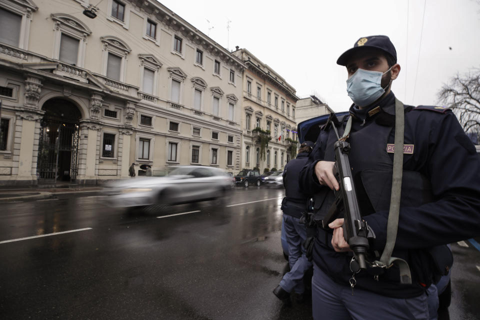 Police officers check vehicles in Milan, Italy, Thursday, Dec. 24, 2020. Police were out in force Thursday imposing new COVID-19 travel restrictions aimed at preventing far-flung families from gathering for Christmas Eve dinner as public health officials appealed for common sense to protect the elderly from infection during the holidays. Italy went into a modified nationwide lockdown Thursday for the Christmas and New Year period, with restrictions on personal movement and commercial activity similar to the 10 weeks of hard lockdown Italy imposed from March to May when the country became the epicenter of the outbreak in Europe. (AP Photo/Luca Bruno)