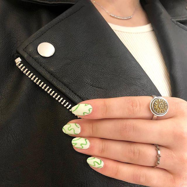 "<p>With greenery making its return after a bleak winter, it's fitting to add some emerald doodles to light green nails. </p><p><a class=""link rapid-noclick-resp"" href=""https://www.amazon.com/Sally-Hansen-Green-Fluid-Ounce/dp/B00HMZORKU?tag=syn-yahoo-20&ascsubtag=%5Bartid%7C10055.g.3186%5Bsrc%7Cyahoo-us"" rel=""nofollow noopener"" target=""_blank"" data-ylk=""slk:SHOP GREEN NAIL PEN"">SHOP GREEN NAIL PEN</a></p><p><a href=""https://www.instagram.com/p/CHsv5_qlIKM/&hidecaption=true"" rel=""nofollow noopener"" target=""_blank"" data-ylk=""slk:See the original post on Instagram"" class=""link rapid-noclick-resp"">See the original post on Instagram</a></p>"