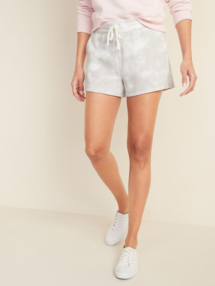 """<p>We love the idea of wearing these <a href=""""https://www.popsugar.com/buy/French-Terry-Drawstring-Shorts-565169?p_name=French%20Terry%20Drawstring%20Shorts&retailer=oldnavy.gap.com&pid=565169&price=18&evar1=fab%3Aus&evar9=47389326&evar98=https%3A%2F%2Fwww.popsugar.com%2Ffashion%2Fphoto-gallery%2F47389326%2Fimage%2F47389484%2FOld-Navy-French-Terry-Drawstring-Shorts&list1=shopping%2Cold%20navy&prop13=api&pdata=1"""" rel=""""nofollow"""" data-shoppable-link=""""1"""" target=""""_blank"""" class=""""ga-track"""" data-ga-category=""""Related"""" data-ga-label=""""https://oldnavy.gap.com/browse/product.do?pid=552082002&amp;pcid=999&amp;vid=1&amp;searchText=tie+dye#pdp-page-content"""" data-ga-action=""""In-Line Links"""">French Terry Drawstring Shorts</a> ($18) with the matching sweatshirt.</p>"""