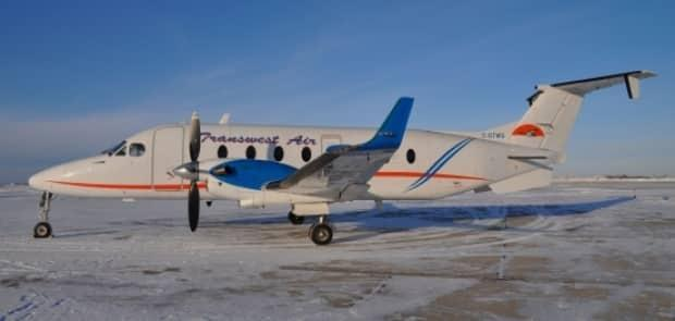 A Transwest Air plane sits at the Prince Albert Airport in a 2015 file photo. A Transwest Air medevac plane had to make an unscheduled landing in Prince Albert on Saturday. (Transwest Air - image credit)