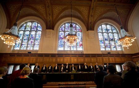 FILE PHOTO: International Court of Justice (ICJ) President and presiding judge Hisashi Owada (8th L) and other judges attend the start of a hearing on Costa Rica's border dispute with Nicaragua at the ICJ peace palace in The Hague, Netherlands, March 8, 2011.    REUTERS/Jerry Lampen/File Photo