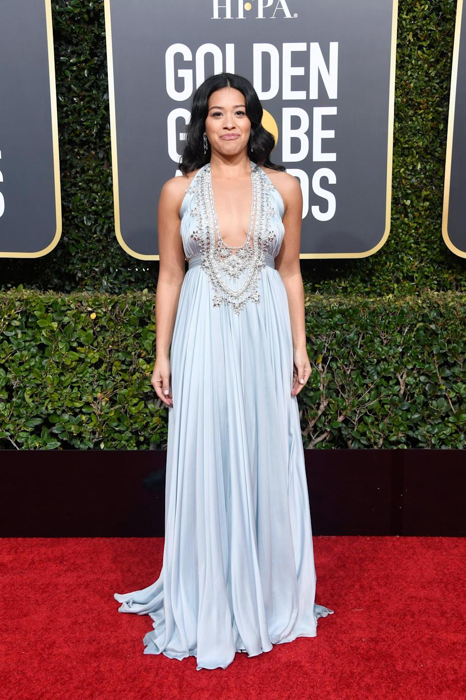 <p>Wearing a Reem Acra dress and Chopard jewels.</p>