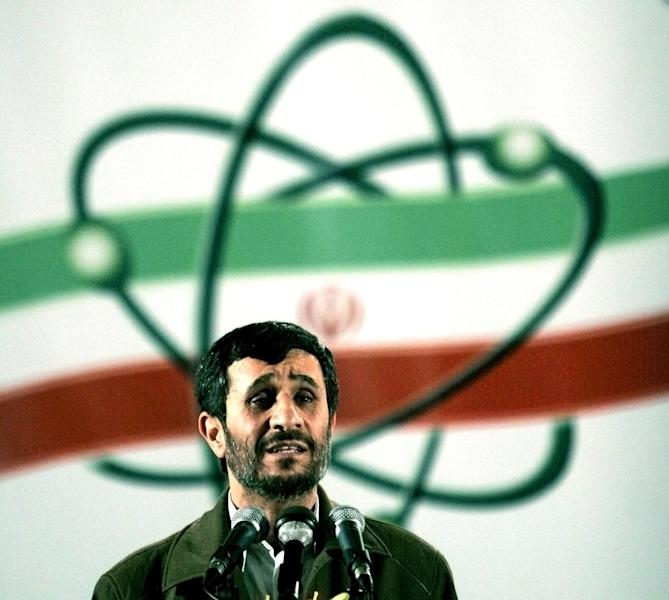 """FILE- In this April, 9, 2007, file photo Iranian President Mahmoud Ahmadinejad, speaks at a ceremony in Iran's nuclear enrichment facility in Natanz, 300 kms 186 (miles) south of capital Tehran, Iran. Iran is considering a more confrontational strategy at possible renewed nuclear talks with world powers, threatening to boost levels of uranium enrichment unless the West makes clear concessions to ease sanctions. Such a gambit outlined by senior Iranian officials in interviews could push Iran's atomic program far closer to Israel's """"red line."""" (AP Photo/Hasan Sarbakhshian, File)"""