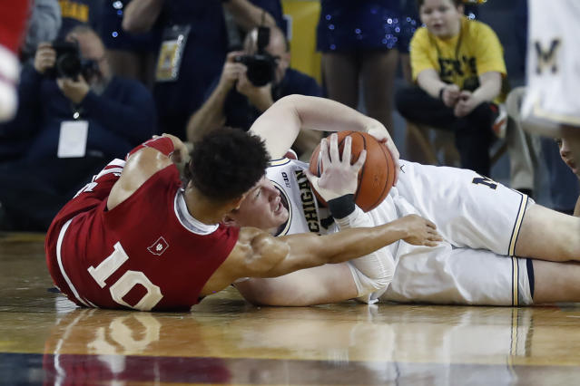 Michigan center Jon Teske, right, and Indiana guard Rob Phinisee (10) struggle for possession during the first half of an NCAA college basketball game, Sunday, Feb. 16, 2020, in Ann Arbor, Mich. (AP Photo/Carlos Osorio)