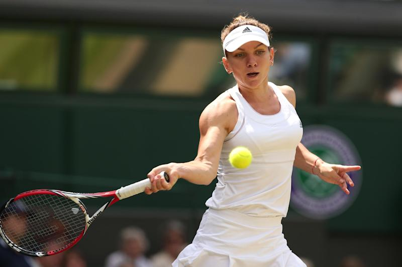 Romania's Simona Halep returns to Germany's Sabine Lisicki during their quarter-final match at Wimbledon on July 2, 2014