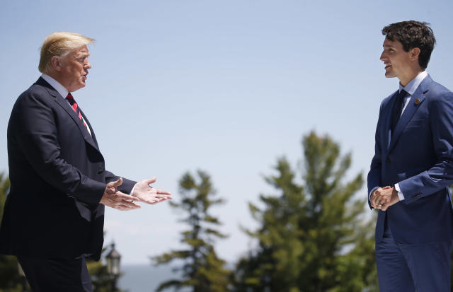U.S. President Donald Trump approaches Canada's Prime Minister Justin Trudeau as he arrives at the G7 Summit in Charlevoix, Quebec, Canada, June 8, 2018. REUTERS/Leah Millis