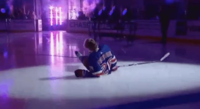 Rangers forward Lias Andersson hits the deck after tripping over a cable during introductions at Madison Square Garden on Thursday night. (Twitter//@PeteBlackburn)