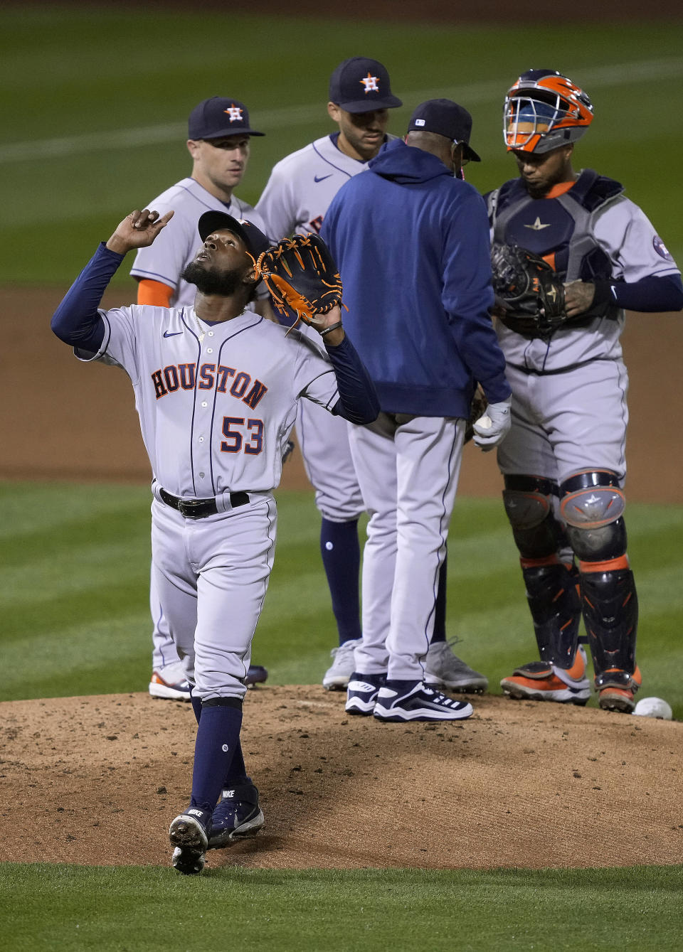 Houston Astros pitcher Cristian Javier (53) points to the sky as he is removed by manager Dusty Baker Jr. during the fourth inning of the team's baseball game against the Oakland Athletics on Friday, April 2, 2021, in Oakland, Calif. (AP Photo/Tony Avelar)