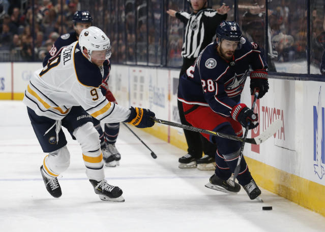 Columbus Blue Jackets forward Oliver Bjorkstrand, right, of Denmark, chases the puck against Buffalo Sabres forward Jack Eichel during the second period of an NHL hockey game in Columbus, Ohio, Monday, Oct. 7, 2019. (AP Photo/Paul Vernon)